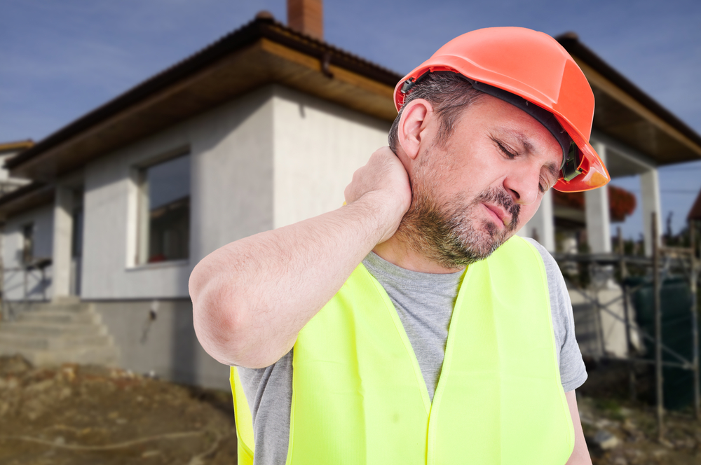 Male engineer or constructor with neck pain