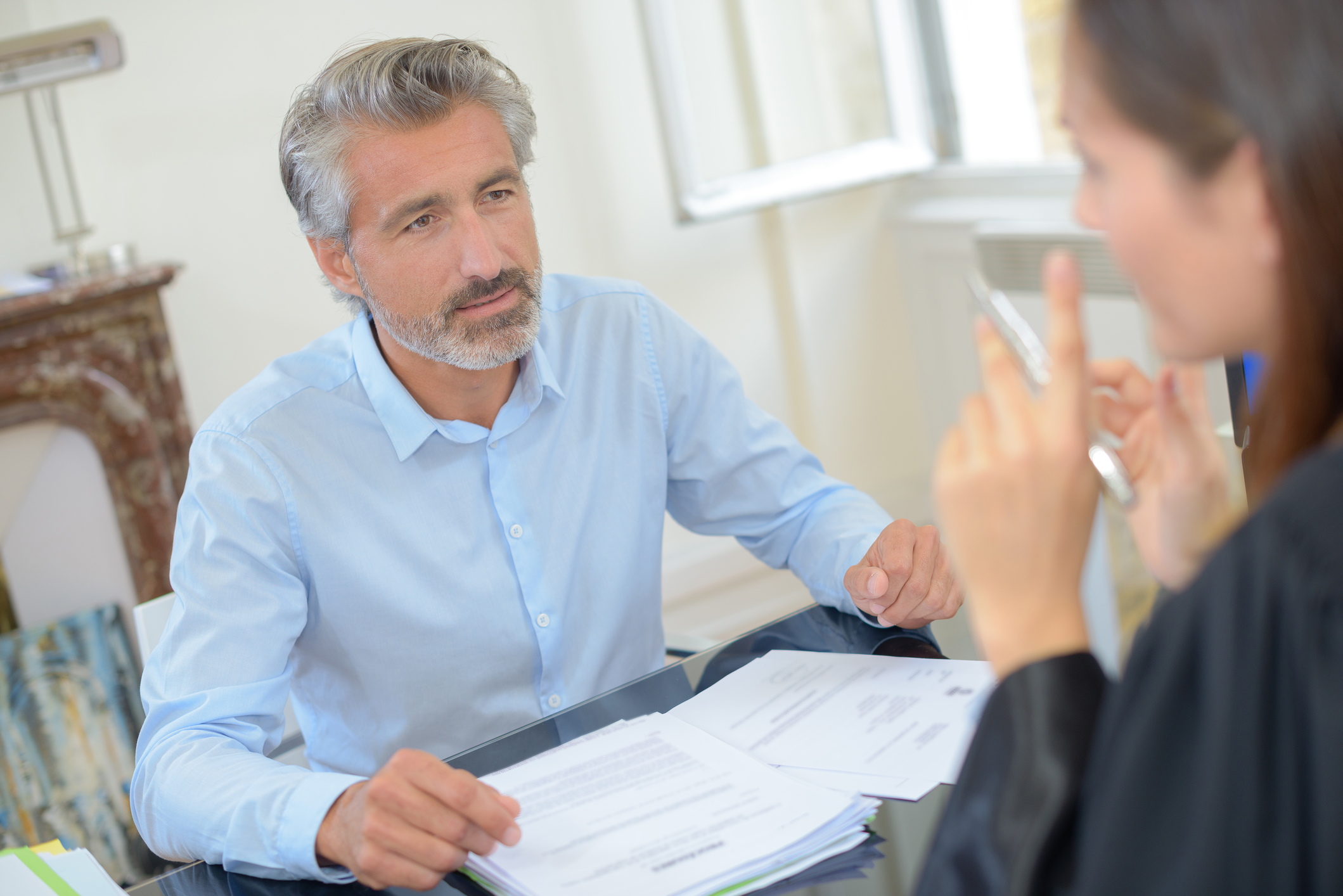 Man asking a workers' comp attorney questions