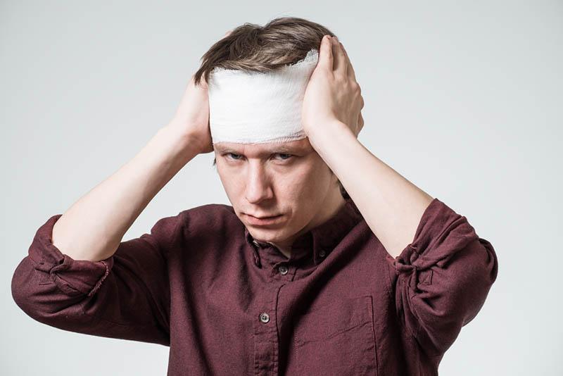 suffering head trauma